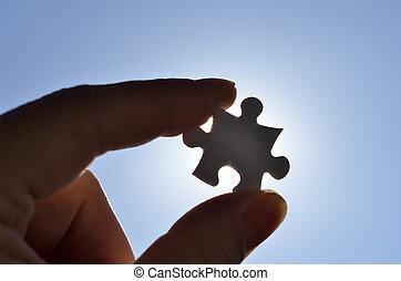 Plain white jigsaw puzzle on Background of blue sky and sun.