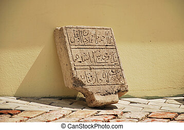Arabic calligraphy - Ancient stone with Arabic calligraphy....