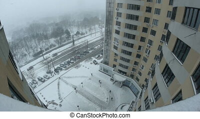 Timelapse of snowing in the city. View from high-rise building.