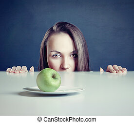 woman with apple - Beautiful woman with apple in front of...