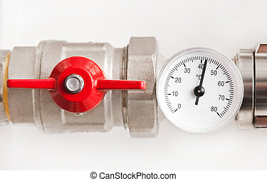 Water thermometer with red valve and metal pipes