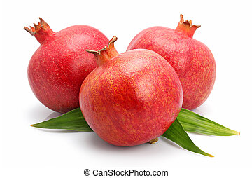 Pomegranate fruits with green leaf isolated on white...
