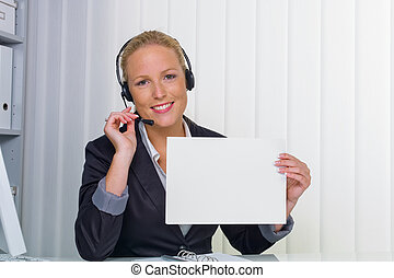 friendly woman with headset in customer service - a friendly...