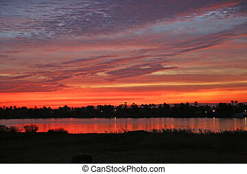 Sunset Nile Luxor - red sky shortly after the sunset at the...