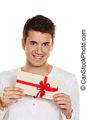 man with gift certificate - man holding a gift card in his...