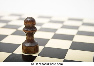 Black Pawn on a chess board