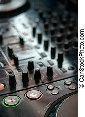 DJ playng on professional mixing controller. Small depth of...
