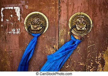 Door handles on ancient temple - Ornate door handles and...