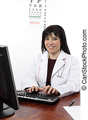 Eye doctor at computer - An optometrist or doctor sitting at...