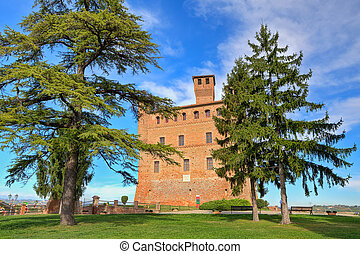 Ancient castle. Grinzane Cavour, Italy. - View on red brick...