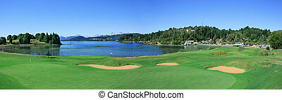 golf course - playing golf by the lake in the summer