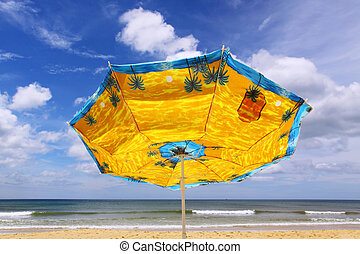 colourful umbrella and sea