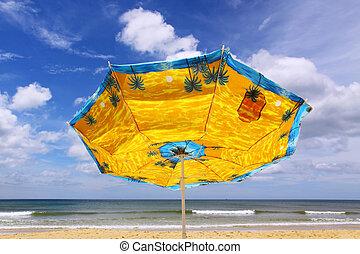 colourful umbrella and sea