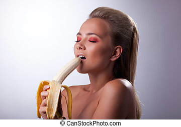 sexy girl eat long banana with desire - pretty young girl...