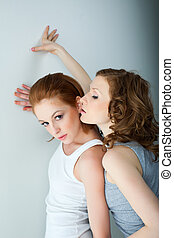 Two beauty woman in tank top near wall lesbian role playing...