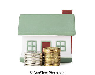 House sale - Little house toy and two stacks of coins...