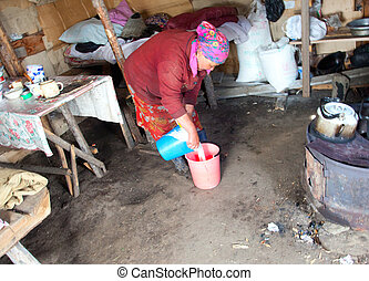 The woman at the camp prepares koumiss