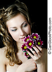 The girl with beautiful hair with chrysanthemum