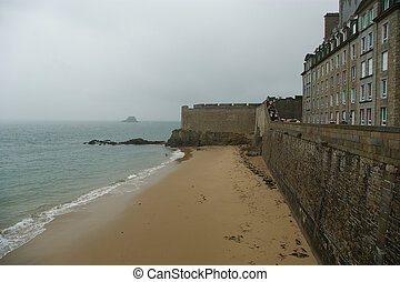 Saint-Malo-- is a walled port city in Brittany in...
