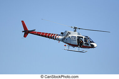 News Chopper - TV-news helicopter in flight with a cameraman...