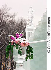 Ice sculptures - Flowers in a vase about an ice palace with...