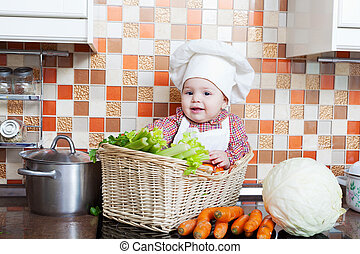 child sits in a wattled basket on a table with vegetables