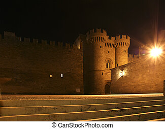 Rhodes Medieval Knights Castle (Palace) at night, Greece -...