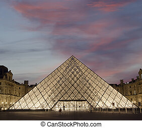 Louvre, Pyramid, which was completed in 1989 by night,...