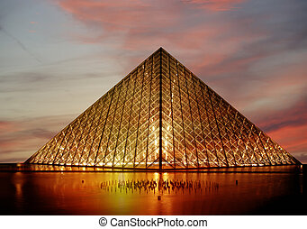 The Louvre Palace and the Pyramid, which was completed in...