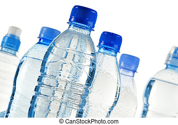 Plastic bottles of mineral water isolated on white -...