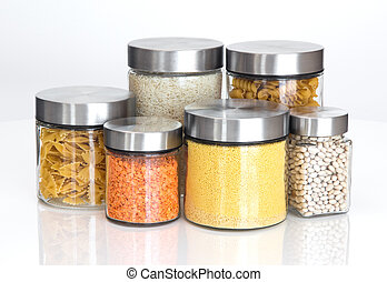 Food ingredients in glass jars, on white background - Food...