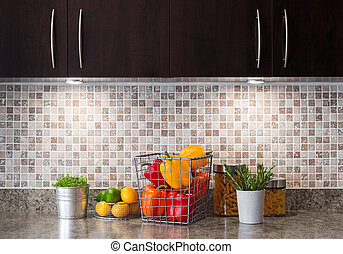 Vegetables, fruits and herbs in a kitchen with cozy lighting...