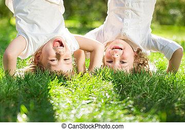 Children having fun - Happy children playing head over heels...