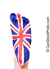 The UK flag on a foot. Travelling to England concept. Eurotrip.