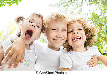 Low angle view portrait of funny children - Low angle view...