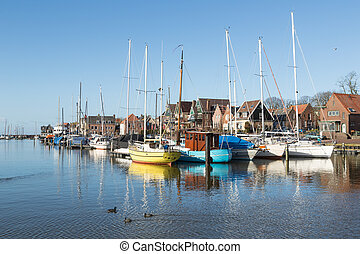 Sailing boats in Dutch harbor of Urk