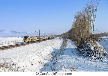 Dutch train in snowy winter landscape