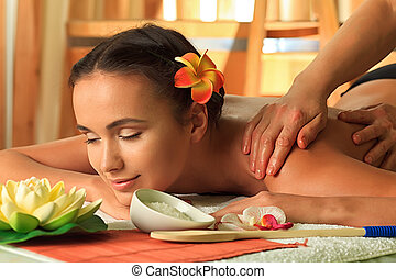 interior spa - Beautiful young woman taking spa treatments...