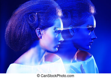 shadow motion - Art fashion photo of a beautiful model with...