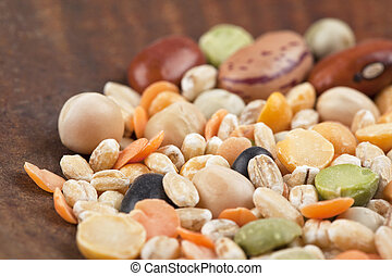 assorted beans on a wooden table - Image of assorted beans...