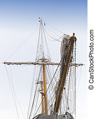 Vintage sailing ship mast and sails - Front view of vintage...