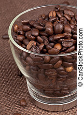 coffee beans in a glass container - Cropped image of coffee...