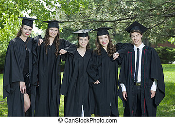 graduation day - Group of successful students with caps and...