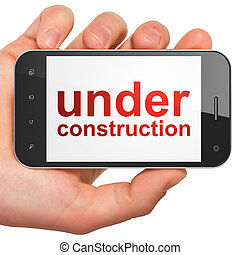 Web design SEO concept: smartphone with Under Construction -...