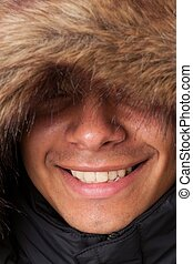 Cold weather fashion. Smiling young man close up.