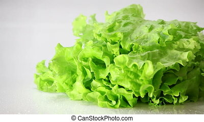 Spray water on the lettuce.