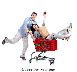 Happy couple with a grocery shopping cart. Isolated on white...