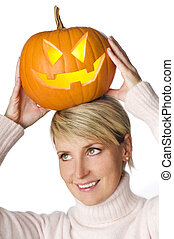 pumpkin - young blond woman holding orange pumpkin close up