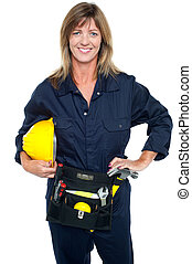 Self assured female architect holding hard hat