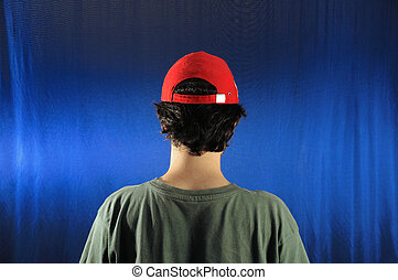 Young male back - Portrait of young casual man wearing a cap...